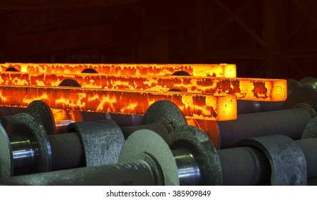 Hot steel ingots on conveyor