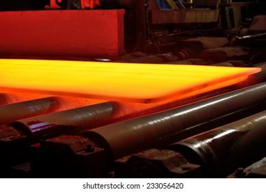 hot steel on conveyor, isolated, soft focus
