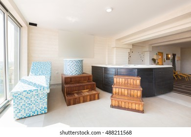 Hot stone and massage bath tub chair in a spa center