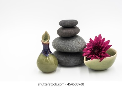 Hot stone,Ceramics with flower in white background.