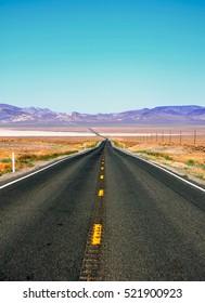A hot summer a deserted road near Carson City in Nevada, usa