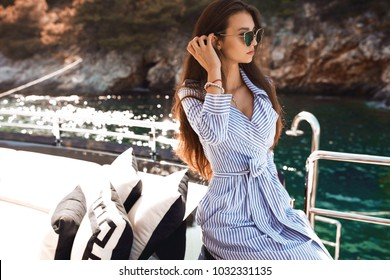 Hot summer girl beauty sexy lady wear fashion silk dress casual clothes party date romantic model woman luxury life style accessory catalog collection pretty face  posing on yacht