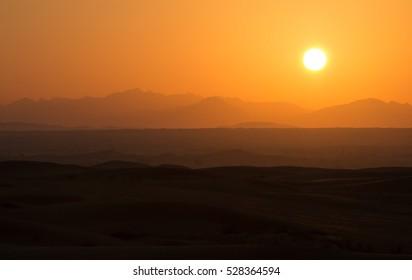 Hot sunrise in the desert dunes of Dubai, United Arab Emirates.