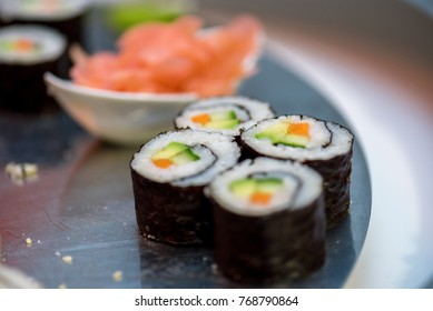 Hot Sushi roll with salmon. Japanese food.