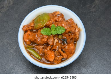 Hot and sweet Chilli chicken curry, spicy dish Mumbai, Delhi India. Popular North Indian side dish for chapati / roti/ naan/ paratha / fried rice / pulao. Indo Chinese cuisine.