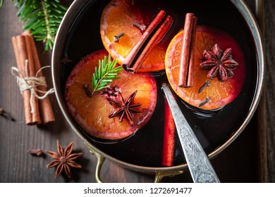 Hot and sweet mulled red wine with cloves and anise