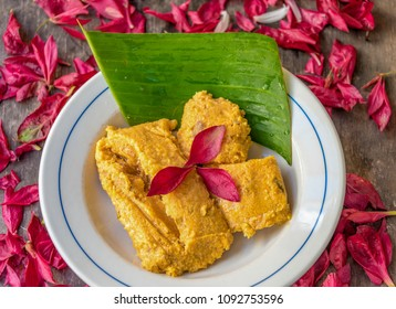 Hot tamales, decorated with with a banana leaf under. Traditional Cuban tamale filled with pork and other types of spices and condiments. like Onions and garlic.