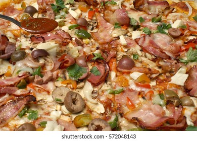 Hot tasty delicious fresh rustic pizza with thick crust