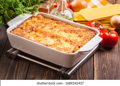 Hot tasty lasagna in ceramic casserole dish