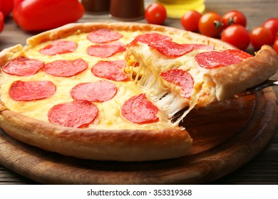 Hot tasty pizza with salami, close up
