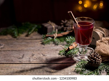 Hot tasty spicy mulled red wine with cinnamon