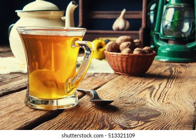 Hot tea for autumn. Old rustic kitchen