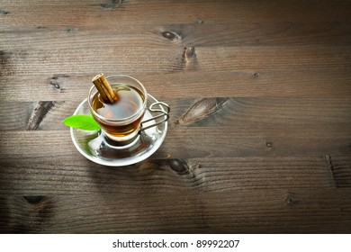 Hot tea and cinnamon in the cup
