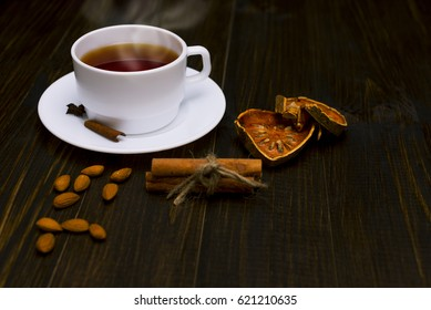 Hot tea with cinnamon  on a wooden table