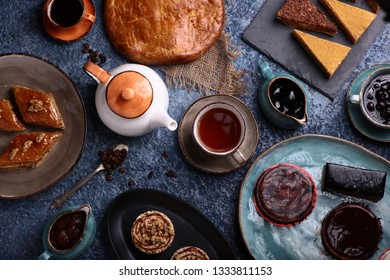 hot tea with cookes mikado lemon cake and other different candies