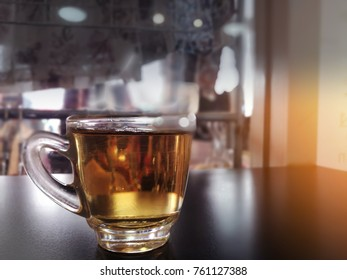 Hot tea cup on dark table background
