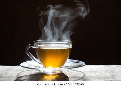 Hot tea cup on wood background