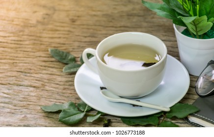 hot tea cup, on wooden table , fresh morning to daily working, warm heart concept, breakfast drinking.