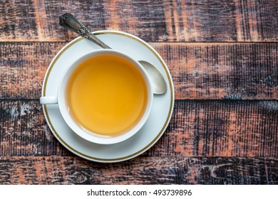 Hot tea cup over wooden background