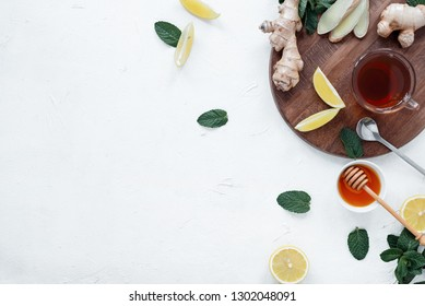 Hot tea with ginger, lemon, honey and mint leaves.Tea against cold.Healthcare concept.Useful tea for immunity.Eyer bird view.