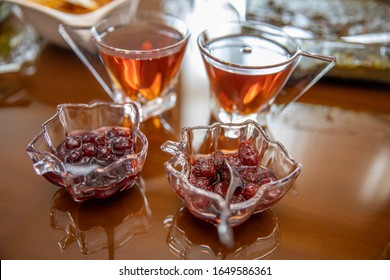 Hot tea in glass glasses and berry jam.  Iranian house, tea on the table