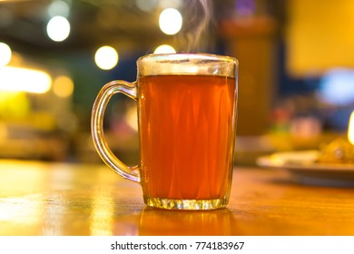 Hot tea glass  on blurry bokeh background
