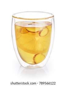 Hot tea with lemon and ginger in a glass with double walls isolated on white background.
