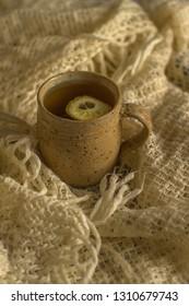 Hot tea with lemon in a vintage mug