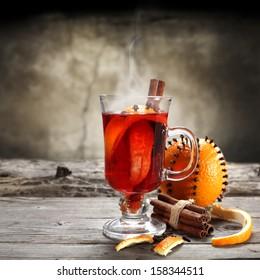 hot tea and orange fruit on sill