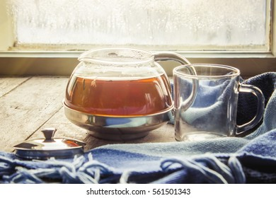 hot tea in the pot near the window. selective focus.