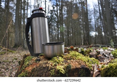 Hot tea in thermos for a walk in the woods while resting