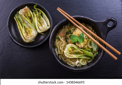 Hot Thai green curry chicken soup with pak choi and moshrooms