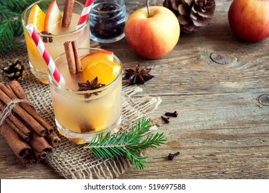 Hot toddy drink (apple orange rum punch) for Christmas and winter holidays - festive Christmas homemade drinks, with copy space