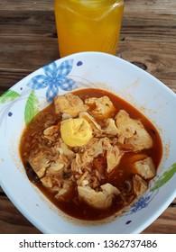 Hot tomyam tofu with eggs