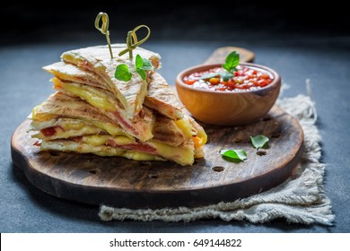Hot tortilla as quesadilla with cheese and ham