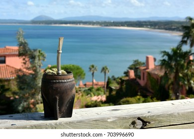 Hot Traditional Uruguay caffeine-rich drink Mate (Yerba Mate) In A Calabash Gourd with the breathtaking view from Whales Peninsula (Punta Ballena) close to Punta del Este resort town on the background