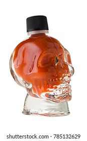 Hot trinidad scorpion chili in skull shaped glass on white background