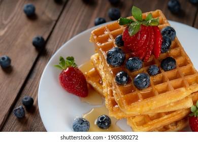 Hot waffle with fresh fruits