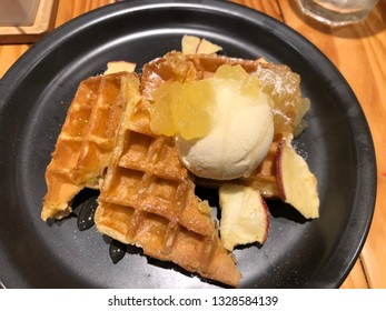 hot waffle served with apple sauce and vanilla icecream