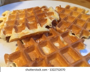 Hot wafles on a white plate.