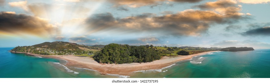 Hot Water Beach, New Zealand. Aerial panoramic view of beautiful seascape at sunset.