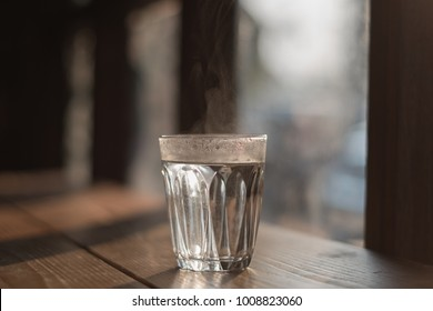 Hot water in clear glass in the evening