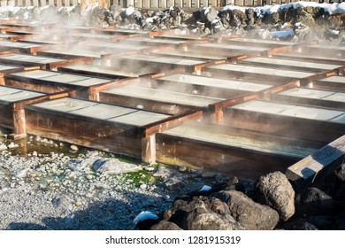 "Hot water field, or known as ""yubatake"" at Kusatsu Onsen at Gunma prefecture, Japan. With an output of 5000l/min, the yubatake ranks among Japan's single most productive hot spring sources."