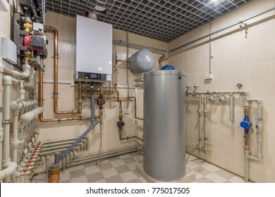 Hot water thermal storage tank. Gas Boiler room with a heating system