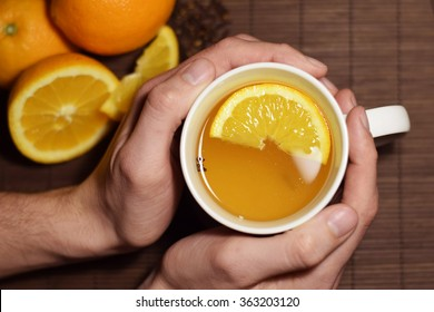 Hot white mulled wine man holding with both hand