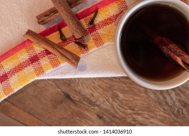Hot Wine Mug (traditional drink at Festa de Sao Joao), on the rustic wooden table. It's Junina Party Time! Northeast of Brazil. Top view.