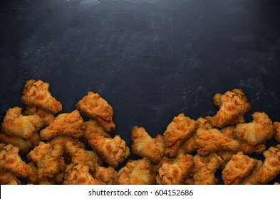 Hot wings on black table.