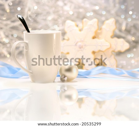 Hot winter drink with sugar cookies on sparkly background