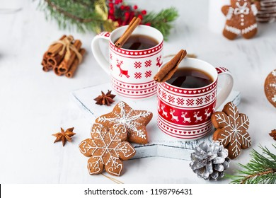 hot winter tea with cinnamon, star anise and ginger cookies