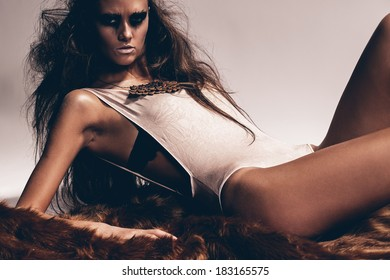 hot woman lies on brown fur coat